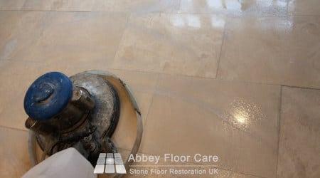 Machine scrubbing Travertine floor in Sutton Coldfield B72